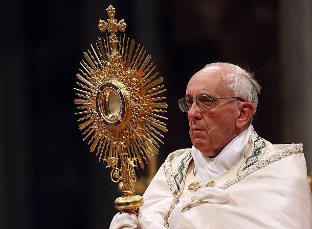 Pope Francis holds the monstrance during the worldwide hour of Eucharistic adoration in St.Peter's Basilica at the Vatican